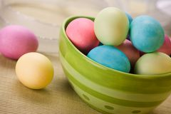 Bowl of Easter Eggs. Large green boel of pastel easter eggs Stock Images
