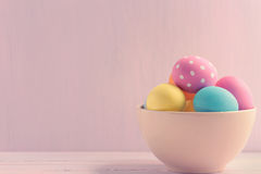 Bowl of Easter eggs. Easter eggs on wooden painted background Stock Images