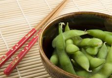 Bowl of edamame with chopsticks Stock Image