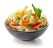Bowl of egg noodles with vegetables. Isolated on white background, selective focus Stock Photo