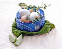 Bowl with eggs. Apple slices and a blue bowl with eggs on a white surface Royalty Free Stock Photo