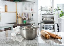 Bowl With Eggs And Rolling Pin In Commercial Royalty Free Stock Images