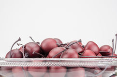 Bowl of Fake Wooden Cherries Stock Photography