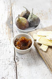 Bowl of fig jam and raw figs Stock Images