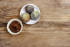 Bowl of fig jam and raw figs Royalty Free Stock Image