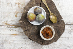 Bowl of fig jam and raw figs Royalty Free Stock Photography