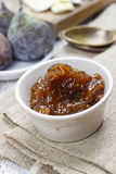 Bowl of fig jam and raw figs Stock Photo