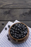 Bowl filled with bilberries, rustic style. Stock Images