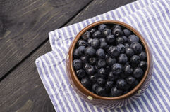 Bowl filled with bilberries, rustic style, horizontal. Stock Photos