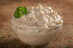 Bowl filled with cream made by tuna fish, butter and onion over Stock Images