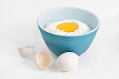 Bowl filled with flour and eggs Stock Photography
