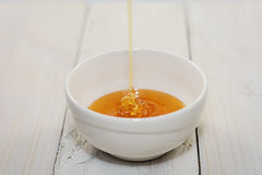 Bowl is filled with flower honey Royalty Free Stock Photography