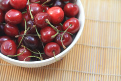 A bowl filled with fresh cherries Stock Photo