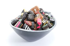 Bowl filled with hard candy. Hard candy in a bowl on a white surface stock images