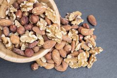 bowl filled with nuts such as almonds, walnuts and hazelnuts stock image