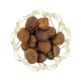 Bowl filled with organic whole shelled roasted chestnuts Royalty Free Stock Images