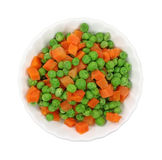 Bowl filled with peas and carrots Stock Photo