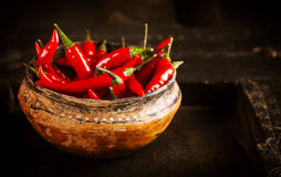 Bowl Filled with Red Chili Peppers on Wooden Table Stock Photography