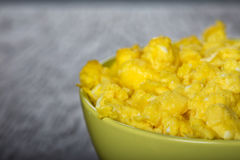 Bowl filled with scrambled eggs Royalty Free Stock Images