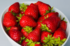 Bowl filled with succulent juicy fresh ripe red strawberries Stock Images