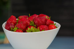Bowl filled with succulent juicy fresh ripe red strawberries Royalty Free Stock Image