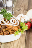 Bowl filles with Kebab meat on wood Stock Photography