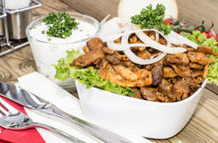 Bowl filles with Kebab meat on wood Royalty Free Stock Photo