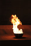 Bowl with fire Royalty Free Stock Image