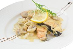 Bowl of fish baked with mushrooms Stock Photography