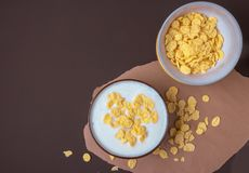 Bowl with flakes in homemade greek yogurt. Healthy food. Breakfast. Top view stock photos