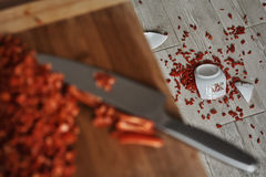 Bowl on the floor. Shattered bowl of porcelain on the floor containing pepper Stock Image