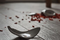 Bowl on the floor. Shattered bowl of porcelain on the floor containing pepper royalty free stock photos