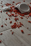 Bowl on the floor. Shattered bowl of porcelain on the floor containing pepper stock photography