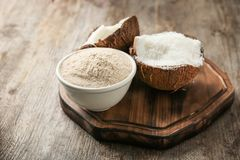 Bowl with flour and desiccated coconut in nut Royalty Free Stock Photography