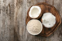 Bowl with flour and desiccated coconut in nut Royalty Free Stock Image