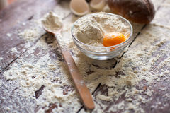 Bowl of flour with egg and bread Stock Photos