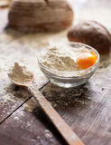 Bowl of flour with egg and bread Royalty Free Stock Image