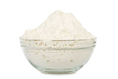 Bowl of flour. Transparent bowl full of flour isolated on white Stock Photography