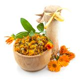 Bowl with flowers of marigold and sea salt Royalty Free Stock Photo