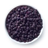 Bowl of freeze dried blueberries. Isolated on white background. Top view royalty free stock photo