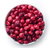 Bowl of freeze dried cranberries. Isolated on white background. Top view royalty free stock image