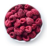 Bowl of freeze dried raspberries. Isolated on white background. Top view stock photo