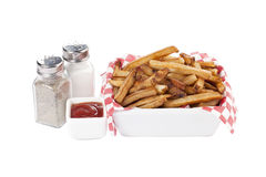 Bowl of french fries with condiments Stock Image