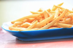 Bowl of french fries on wooden table Stock Photos
