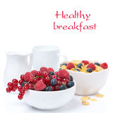 Bowl with fresh berries, corn flakes and milk Royalty Free Stock Photo