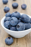 Bowl of fresh blueberries on a wooden background Stock Photo
