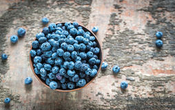 Bowl of fresh blueberries. On the wooden table Stock Images