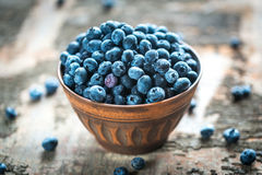 Bowl of fresh blueberries. On the wooden table Stock Photo