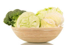 Bowl  fresh broccoli, cauliflower, Chinese cabbage, and  on white. Stock Photos