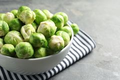 Bowl of fresh Brussels sprouts and napkin on table, closeup. Space for text. Bowl of fresh Brussels sprouts and napkin on grey table, closeup. Space for text royalty free stock photo